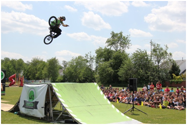 Pictured: A stunt rider for Dialed BMX Shows performs for our students